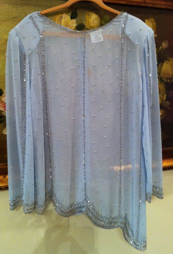 Baby Blue Beaded Chiffon blouse with beads and sequences , accented with luster of beads on hem and sleef cuff