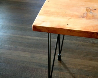 modern reclaimed industrial bench with steel leveling hairpin legs