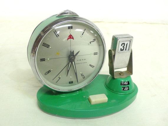 vintage alarm clock with date aqua blue color