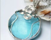 Swirly blue glass wire wrapped pendant