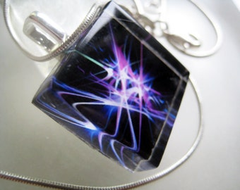 "Purple Synapse-- Fine Art Glass Tile Pendant 7/8"" square with silver chain and black satin cord."