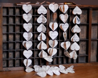 Heart garlands made from vintage sheet music. 6ft long