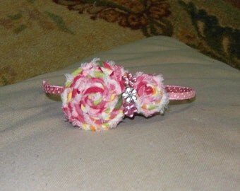 Rolled fabric flower headband
