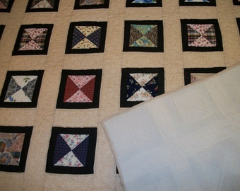 Quilt with matching quilted pillow shams, beautifully hand-quilted.