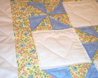 Pinwheel baby quilt, hand-quilted, blue, white and yellow