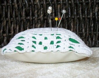 Green and white crochet pincushion