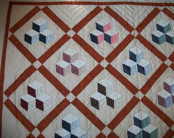 Patchwork quilt, hand-quilted, tumbling blocks design