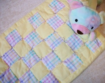 Yellow doll quilt with pastel plaid blocks