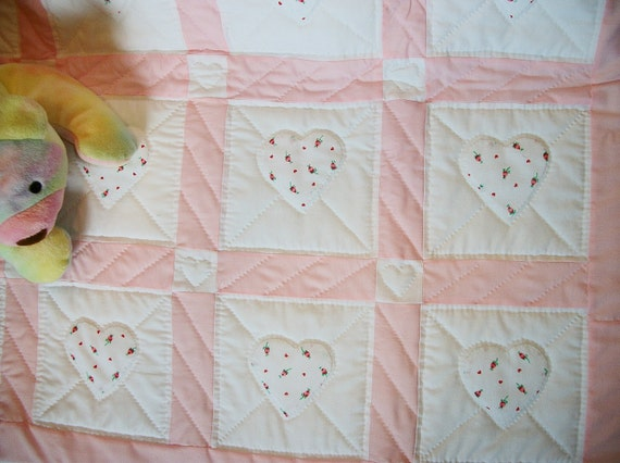 Pink baby quilt, hand-quilted with appliqued hearts