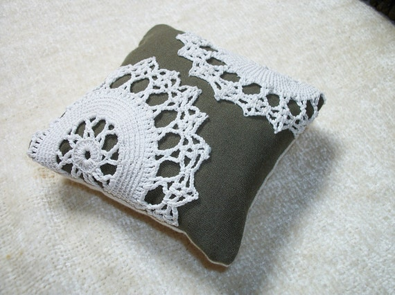 Pincushion, vintage crochet on olive background