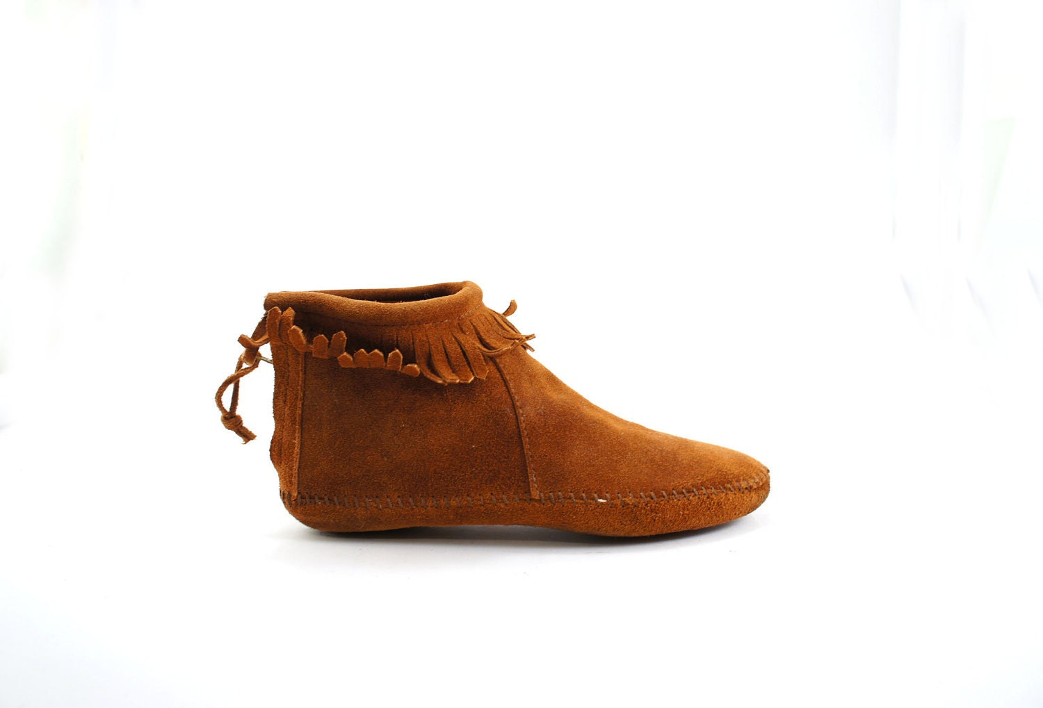 moccasin ankle boots in brown suede leather with fringe cuff