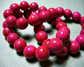 Fossiles perles sombre Fuchsia rond 10mm