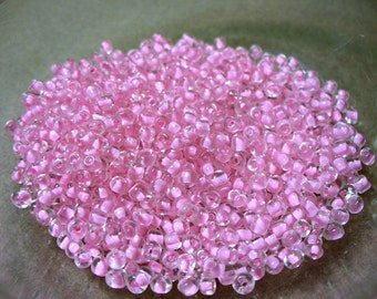 Seed Beads Clear with Pink Lining 2-3mm 28 grams