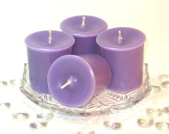 4 pack votive candles Love Spell(type) scent