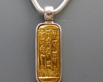 Sumer - pendant of pure gold repoussee on sterling silver