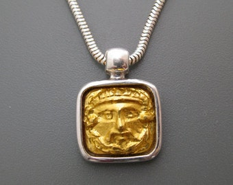 Face of Zeus - pendant of pure gold repoussee on sterling silver