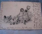 Antique Postcard 1905 Postmark Surrey Girls Pulling Cats in Basket