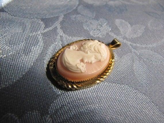 White Cameo Pink Background Goldtone Border Pendant
