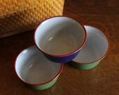 vintage stackable enamel bowls, blue & green with red trim