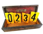 One vintage school bus yellow metal number. Tin two sided gas station sign.