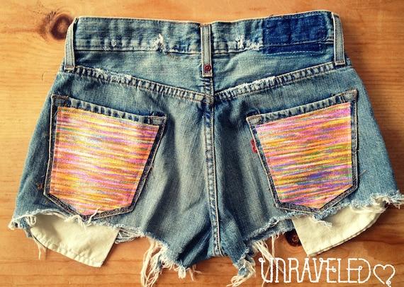 Levi Denim Shorts, Multi Color Tribal Pockets (Size SMALL)