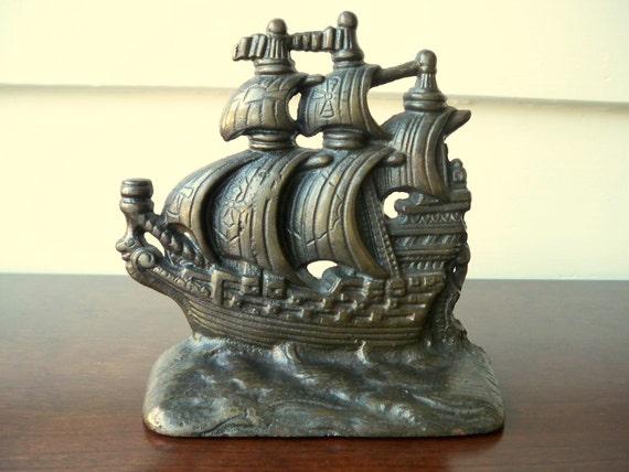 Vintage single nautical iron bookend.  Nautical iron door stop.