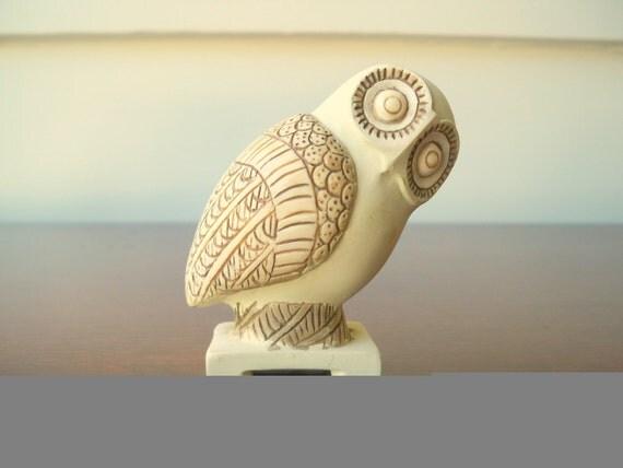 Owl figurine on pedestal