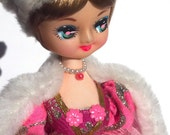 pretty in pink:  1970's big eye doll, white faux fur hat, pink cape with faux fur trim