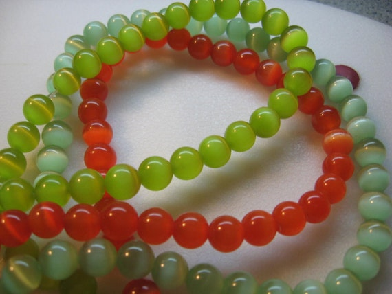 22 pcs of Lime green   and 22  Orange Cat Eye Beads
