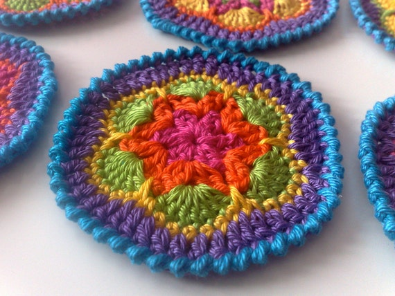 Six  Crocheted Coasters Colorful with 'blue' border