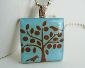 A Bird in the Tree Pendant with Free Necklace