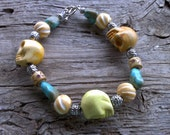 skull,bone beads,magnesite bracelet 8 1/2 inch
