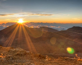 Rising sun rays Haleakala Maui orange light sun flare  photography