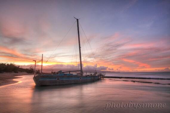 Shipwreck adrift  sailboat calm water sunset Hawaii pink orange blue