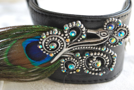 Black leather cuff with peacock feather and figure