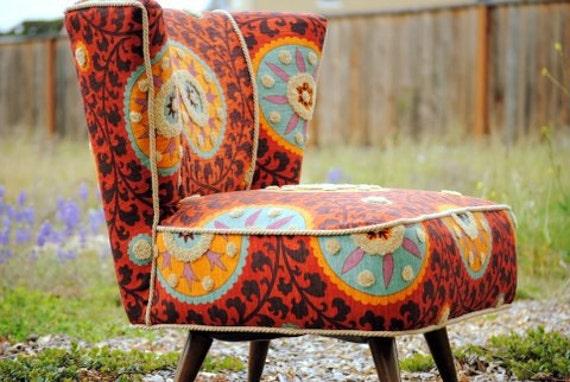 Restored Mid Century Swivel Slipper Chair, reupholstered in Tribal- Sunset