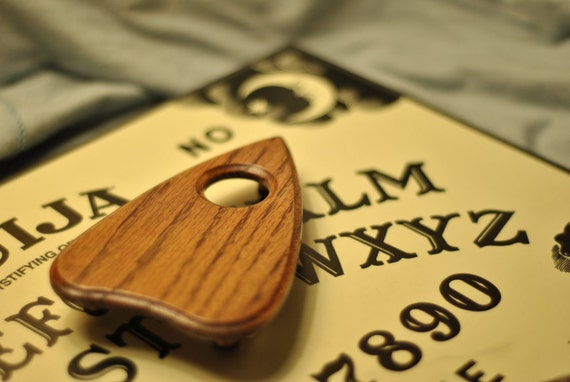 Beautiful hand carved Ouija type planchette.