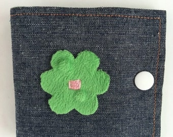 Needle case in blue denim, pink, green, and orange