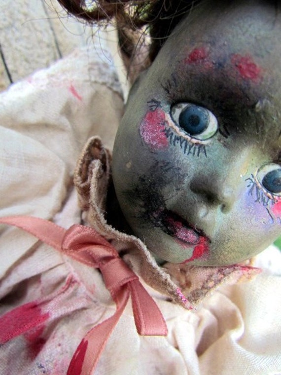 Zombie baby doll, play with me, needs live friends to replace her dead ones