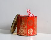 Red and gold and black Cadbury vintage tin pot with filigree pattern, home storage