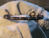 Leather hand stitched bracelet. B54