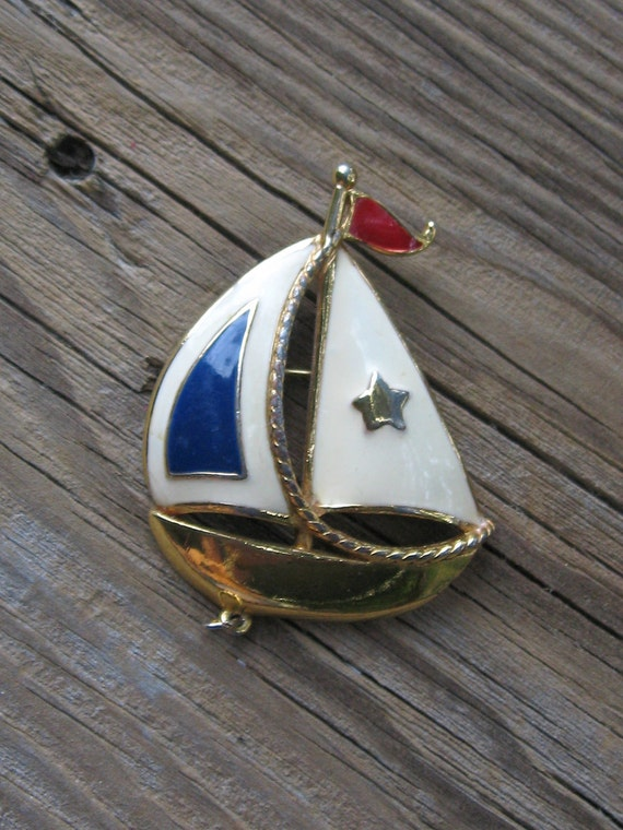 Vintage Pin The Cutest Sailboat  Ever. Vintage Nautical Style in Goldtone with Red, White and Blue Enamel made by Avon