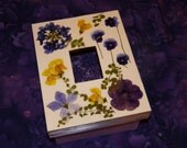Wooden box with pressed flowers