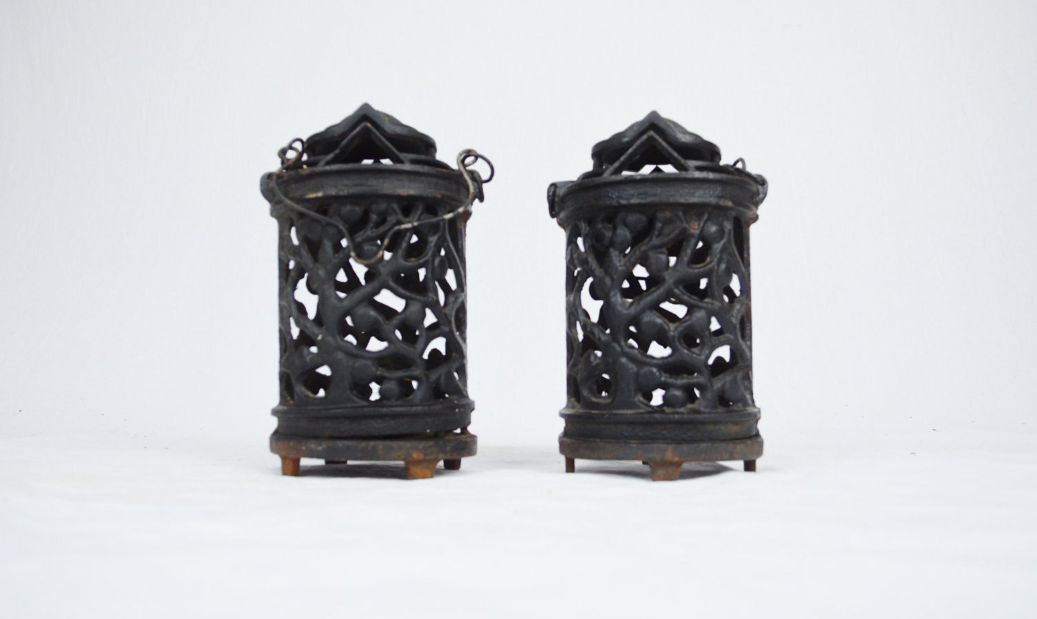 Antique Cast Iron Hanging Candle Lanterns by LuccaBalesVintage