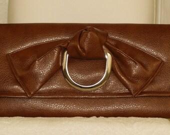 Brown Pebbled Vegan Envelope Handbag with Metal Rigging Dee Accent