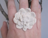 White dahlia statement ring as created for Rachel Zoe