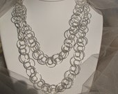 Complex sterling silver chain necklace.