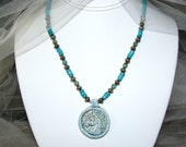 Necklace includes Turquoise, Sterling silver and a porcelain horse head pendant.