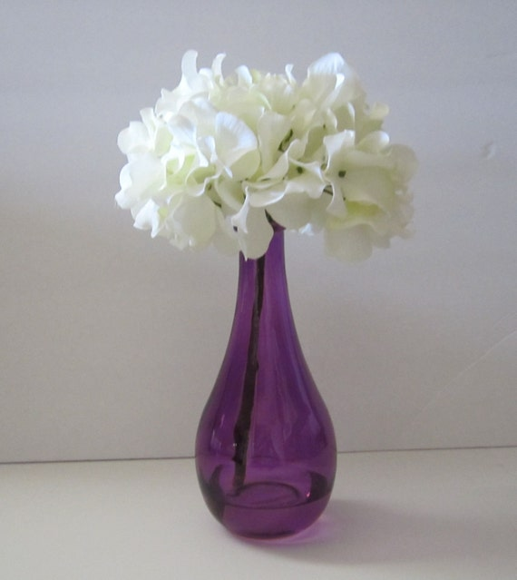 Floral Arrangement In 8 Inch Purple Vase With A Single White