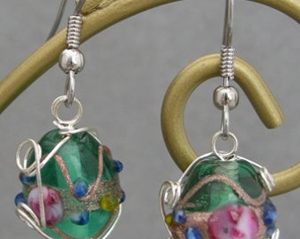 Pink accented Lampworked Glass